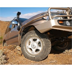 Side rails protecting a 100 Series Landcruiser
