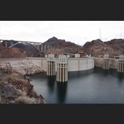 View over back of Hoover Dam, bridge in background
